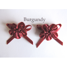 Ribbon Rosette with Bow Trim. Colour: Burgundy.