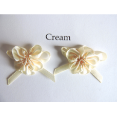 Ribbon Rosette with Bow Trim. Colour: Cream