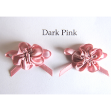 Ribbon Rosette with Bow Trim. Colour: Dark Pink.