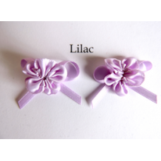 Ribbon Rosette with Bow Trim. Colour: Lilac.