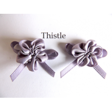 Ribbon Rosette with Bow Trim. Colour: Thistle.