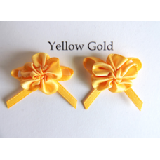 Ribbon Rosette with Bow Trim. Colour: Yellow Gold.